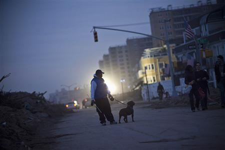 Northeast cleans up from storm Sandy, death toll rises