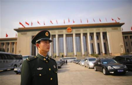 A paramilitary policeman stands guard in front of the Great Hall of the People, the venue of the 18th National Congress of the Communist Party of China, in Beijing, November 9, 2012. REUTERS/Petar Kujundzic