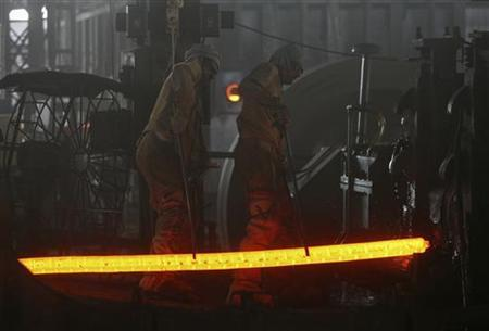 Labourers work inside an iron factory on the outskirts of Jammu October 1, 2012. REUTERS/Mukesh Gupta/Files
