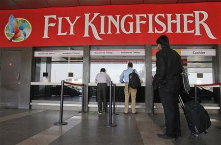 Customers stand at a Kingfisher Airlines reservation office at the domestic airport in Mumbai, February 16, 2012. REUTERS/Vivek Prakash/Files