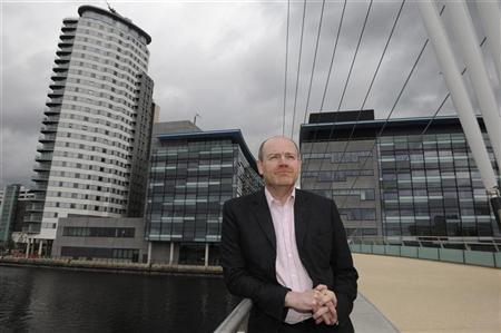 Mark Thompson poses for media on a visit to Media City the company's new northern headquarters in Salford, northern England in this May 10, 2011 file photograph. REUTERS/Nigel Roddis/Files