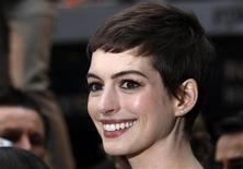 """Actress Anne Hathaway poses for photographers as she arrives at the European Premiere of """"The Dark Knight Rises"""" in Leicester Square, central London, July 18, 2012. REUTERS/Andrew Winning"""