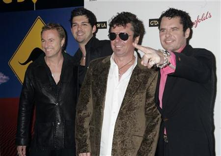 Australian band INXS poses at the Penfolds Icon Gala Dinner during G' Day LA Australia Week 2006 in Hollywood January 14, 2006. REUTERS/Fred Prouser