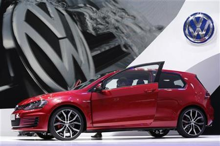 A new model of the Volkswagen Golf GTI is displayed on media day at the Paris Mondial de l'Automobile September 27, 2012. The Paris auto show opens its doors to the public from September 29 to October 14. REUTERS/Christian Hartmann