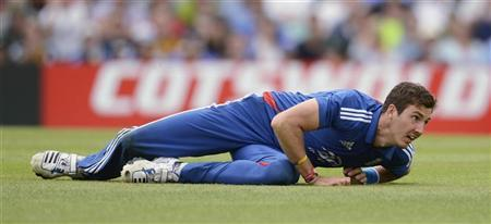 England's Steven Finn looks on after running out Australia's David Hussey during the second one-day international at the Oval cricket ground in London July 1, 2012. REUTERS/Philip Brown