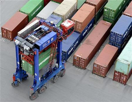 A van carrier transports a container at the container terminal ''Burchardkai'' of the Hamburger Hafen und Logistik AG (HHLA) in the harbour of Hamburg on late October 17, 2012. REUTERS/Fabian Bimmer (GERMANY - Tags: BUSINESS MARITIME)
