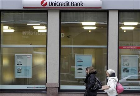 People walk past UniCredit Bank branch in Riga February 13, 2012. REUTERS/Ints Kalnins (LATVIA - Tags: BUSINESS)