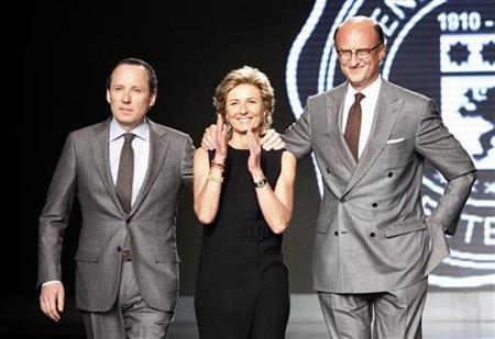 File photo of (L-R) Gildo, Anna and Paolo Zegna acknowledging applause at the end of the Ermenegildo Zegna Fall/Winter 2010/11 Men's collection during Milan Fashion Week January 16, 2010. REUTERS/Alessandro Garofalo