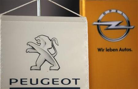 The logo of German General Motors daughter Opel and French car maker Peugeot are seen at a Opel and Peugeot dealership in Leverkusen near Cologne October 22, 2012. REUTERS/Wolfgang Rattay