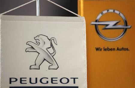 The logo of German General Motors daughter Opel and French car maker Peugeot are seen at a Opel and Peugeot dealership in Leverkusen near Cologne October 22, 2012. REUTERS/Wolfgang Rattay (GERMANY)