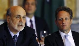 U.S. Secretary of the Treasury Timothy Geithner (R) listens to Federal Reserve Chairman Ben Bernanke (L) at the Treasury Department for the meeting of the Financial Stability Oversight Council in Washington November 13, 2012. REUTERS/Gary Cameron