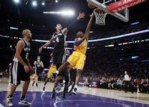 Los Angeles Lakers Kobe Bryant (R) goes up to shoot against the San Antonio Spurs during their NBA basketball game in Los Angeles, November 13, 2012. REUTERS/Lucy Nicholson