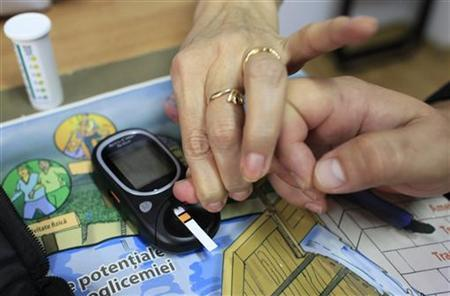 Diabetes educator Cornelia Cristofor teaches how to perform a blood sugar test at the Nicolae Paulescu National Institute for Diabetes, Nutrition and Metabolic Diseases in Bucharest, November 13, 2012. REUTERS/Radu Sigheti