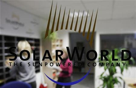 The logo of SolarWorld AG is pictured at the reception in a plant in Freiberg near Dresden December 17, 2008. The SolarWorld AG group of companies produce high quality solar power technology. The company is involved at all levels of the solar value chain and combines all activities of the industry from silicon as the raw material to turn-key solar power system. REUTERS/Hannibal Hanschke (GERMANY)