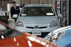 A Toyota Motor Corp Prius vehicle and other vehicles are displayed at the company's showroom in Tokyo November 14, 2012. Toyota said it will recall around 2.77 million vehicles worldwide, including certain models of the Prius, due to problems with the steering mechanism and the hybrid system water pump, its second multi-million car recall in two months. REUTERS/Yuriko Nakao