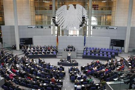 German Chancellor Angela Merkel (C) addresses a session of the Bundestag, German lower house of parliament, at the Reichstag in Berlin September 12, 2012. REUTERS/Fabrizio Bensch (GERMANY - Tags: BUSINESS POLITICS)