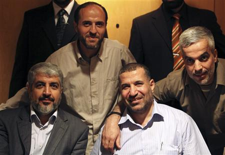 Hamas leader Khaled Meshaal (bottom L) poses for a photograph with Ahmed Al-Jaabari (bottom R), top commander of Hamas armed wing Al-Qassam brigades, after a prisoner swap deal between Hamas and Israel, in Cairo, in this October 18, 2011 file photo. REUTERS/Hamas Office/Handout/Files