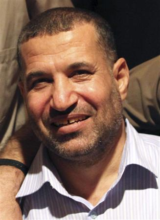 Ahmed Al-Jaabari, top commander of Hamas armed wing Al-Qassam brigades, poses for a picture after a prisoner swap deal between Hamas and Israel, in Cairo, in this October 18, 2011 file photo. REUTERS/Hamas Office/Handout/Files