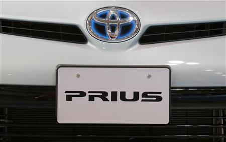 A logo of Toyota Motor Corp on its Prius vehicle is seen at the company's showroom in Tokyo November 14, 2012. REUTERS/Yuriko Nakao