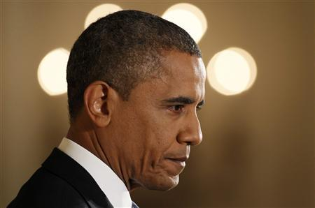 U.S. President Barack Obama pauses while addressing his first news conference since his reelection, at the White House in Washington November 14, 2012. REUTERS/Kevin Lamarque