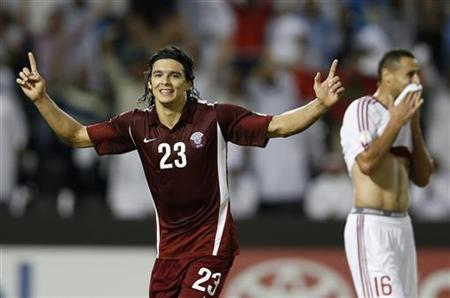 Qatar's Sebastian Soria celebrates after scoring a goal against Lebanon during their 2014 World Cup qualifying soccer match in in Doha, November 14, 2012. REUTERS/Fadi Al-Assaad