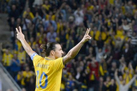 Inspired Ibrahimovic scores four, no Messi record