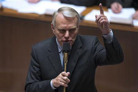 France's Prime Minister Jean-Marc Ayrault gestures as he attends the questions to the government session at the National Assembly in Paris, November 14, 2012. REUTERS/Charles Platiau (FRANCE - Tags: POLITICS)