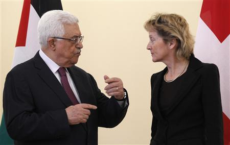 Swiss President and Finance Minister Eveline Widmer-Schlumpf (R) listens to Palestinian President Mahmoud Abbas during an official visit in Bern November 15, 2012. REUTERS/Ruben Sprich