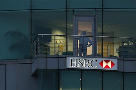 A man uses a mobile phone in a branch of HSBC in St Helier, Jersey November 12, 2012. REUTERS/Stefan Wermuth
