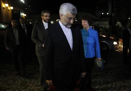 EU foreign policy chief Catherine Ashton (R) and Iran's chief negotiator Saeed Jalili (C) walk before their meeting in the garden of the Iranian Consulate in Istanbul September 18, 2012. REUTERS/Osman Orsal