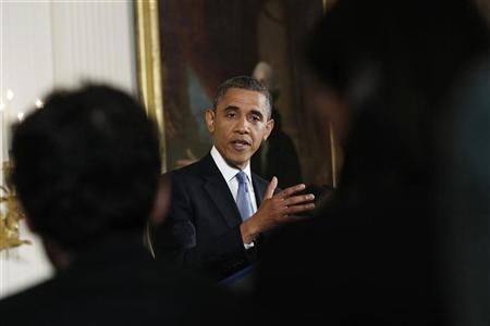 U.S. President Barack Obama gestures during his first news conference since he was re-elected, at the White House in Washington November 14, 2012. REUTERS/Kevin Lamarque