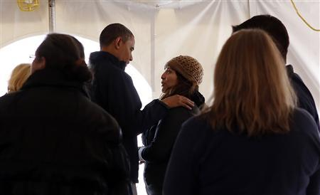 U.S. President Barack Obama greets residents affected by Hurricane Sandy at a Staten Island FEMA disaster recovery center in New York, November 15, 2012. Obama was due to visit areas of New York still without power on Thursday, 17 days after Superstorm Sandy tore across the eastern seaboard, showing his ongoing concern for victims of the storm even as his administration turns to budget and international challenges. REUTERS/Kevin Lamarque