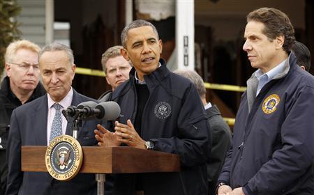 U.S. President Barack Obama speaks after touring a street in a hurricane battered Staten Island neighborhood in New York November 15, 2012. REUTERS/Kevin Lamarque