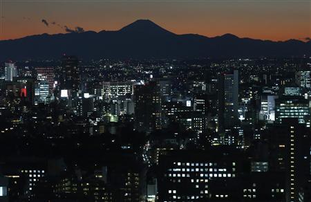 The silhouette of Japan's highest Mt. Fuji is seen beyond buildings in Tokyo November 15, 2012. REUTERS/Toru Hanai