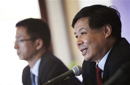 China's Vice Finance Minister Zhu Guangyao (R) addresses the media during a news conference at a hotel in Los Cabos June 17, 2012. REUTERS/Victor Ruiz Garcia