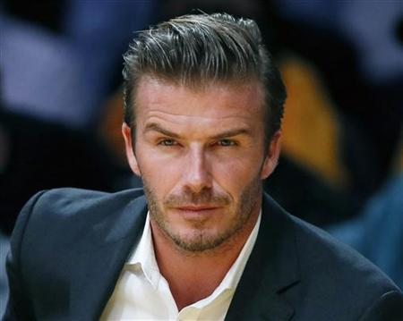 British soccer star David Beckham sits courtside as the Los Angeles Lakers play the Dallas Mavericks during their NBA basketball game in Los Angeles, October 30, 2012. REUTERS/Lucy Nicholson/Files