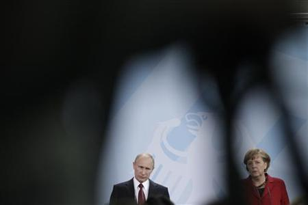 German Chancellor Angela Merkel and Russian President Vladimir Putin address the media after talks in Berlin, June 1, 2012. Russia does not supply weapons to its long-standing ally Syria that could be used in a civil war, Putin said on Friday, responding to U.S. criticism of a ''reprehensible'' arms shipment to Damascus. REUTERS/Tobias Schwarz (GERMANY - Tags: POLITICS)
