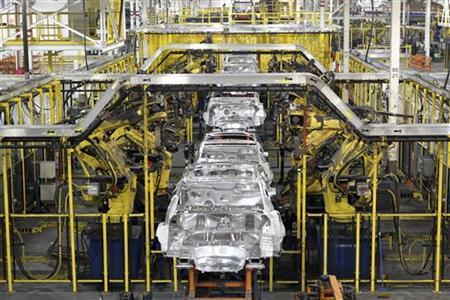 Chevrolet Cruze chassis move along the assembly line at the General Motors Cruze assembly plant in Lordstown, Ohio July 22, 2011. REUTERS/Aaron Josefczyk