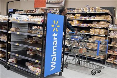 A man walks past shelves of bread as people prepare for Hurricane Sandy at a Walmart store in Virginia Beach, Virginia, October 28, 2012. REUTERS/Rich-Joseph Facun