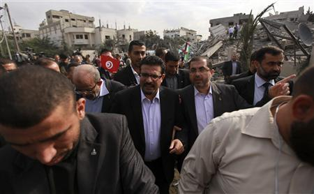 Tunisia's Foreign Minister Rafik Abdessalem (3rd R) visits the office building of Hamas Prime Minister Ismail Haniyeh that was destroyed by an Israeli air strike in Gaza City November 17, 2012. REUTERS/ Mohammed Salem
