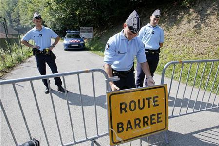 French gendarmes block access to a road to La Combe d'Ire in Chevaline near Annecy, southeastern France, September 7, 2012 after Saad al-Hilli, an Iraqi-born British engineer, was found shot dead with his wife and mother-in-law in their BMW car in a car on a road in the Alps.