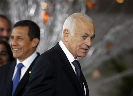 Secretary-General of the Arab League Nabil Elaraby (R) walks near Peru's President Ollanta Humala upon his arrival at the inauguration ceremony of the Latin American and Arab heads of states summit in Lima, October 2, 2012. REUTERS/Mariana Bazo
