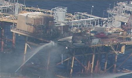 Commercial vessels spray water to extinguish a platform fire on board an offshore oil platform operated by Houston-based Black Elk Energy Offshore Operations LLC. 20 miles offshore of Grand Isle, Louisiana in the Gulf of Mexico November 16, 2012 in this handout photo released by the U.S. Coast Guard. REUTERS/U.S. Coast Guard/Handout