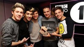 Members of boy band One Direction pose at the BBC's Radio One studio to mark their topping the British singles and album charts on Sunday November 18, 2012, in this handout publicity photo. REUTERS/Handout