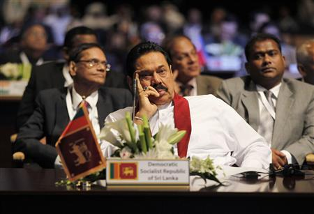 Sri Lanka's President Mahinda Rajapaksa attends the World Energy Forum during the first day of the programme at the Dubai World Trade Centre in this October 22, 2012 file photo. From foreign hotel towers sprouting on Colombo's seafront to the new motorbikes and mobile phones buzzing in war-ravaged Jaffna, at first glance, Sri Lanka seems to be living up to its claim as Asia's latest frontier market. But private businesses are not investing enough, threatening the boom that has swept the island since the end of a long ethnic conflict, while President Mahinda Rajapaksa and his family are tightening their grip on the economy and institutions with what critics see as an unusually personalised system of government. REUTERS/Jumana El Heloueh/Files