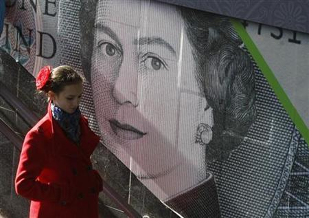 A woman passes by an outdoor advert with an image of the British pound bank note in central Kiev, October 26, 2012. REUTERS/Anatolii Setpanov