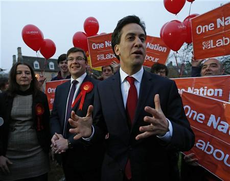 Leader of the opposition Labour party Ed Miliband (R) talks to the media with Andy Sawford (C), winner of the Corby by-election, in Middleton, central England November 16, 2012. REUTERS/Eddie Keogh