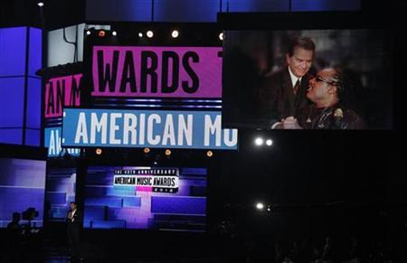 Ryan Seacrest introduces Stevie Wonder in a tribute to the late Dick Clark at the 40th American Music Awards in Los Angeles, California, November 18, 2012. REUTERS/Danny Moloshok