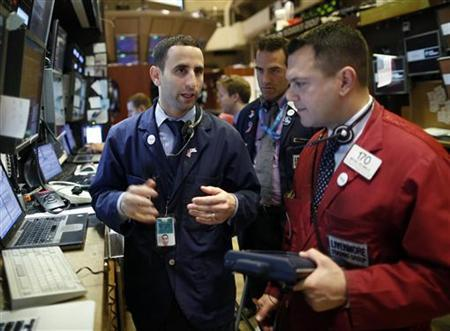Trading specialists work on the floor of the New York Stock Exchange, November 19, 2012. REUTERS/Chip East