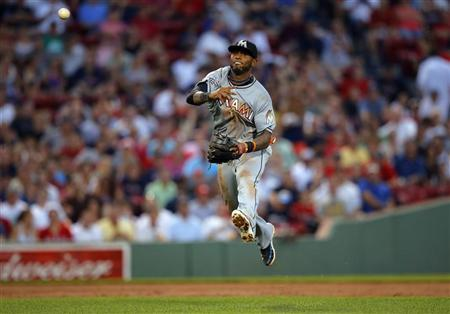 Miami Marlins shortstop Jose Reyes throws out Boston Red Sox Dustin Pedroia at first base in the third inning of their MLB interleague baseball game at Fenway Park in Boston, Massachusetts June 21, 2012. REUTERS/Brian Snyder